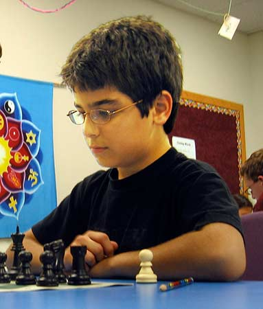 This is a photograph of Aram Bejnood playing chess.