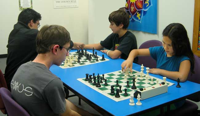 This is a photograph of a group of chess players.