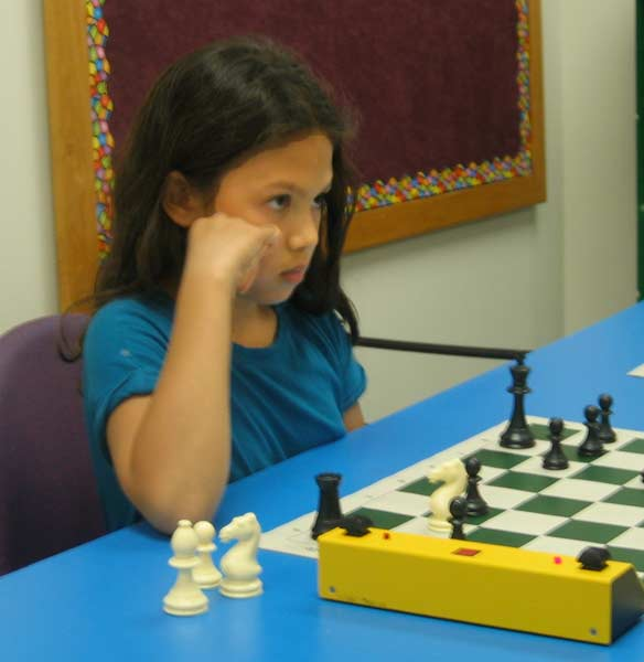 This is a photograph of Isabel Gellert playing chess.