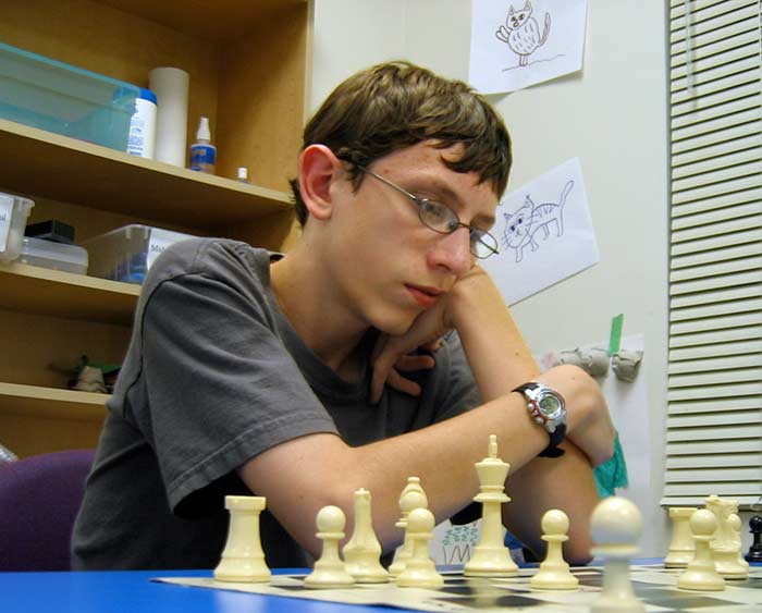 This is a photograph of Matthew Marsh playing chess.